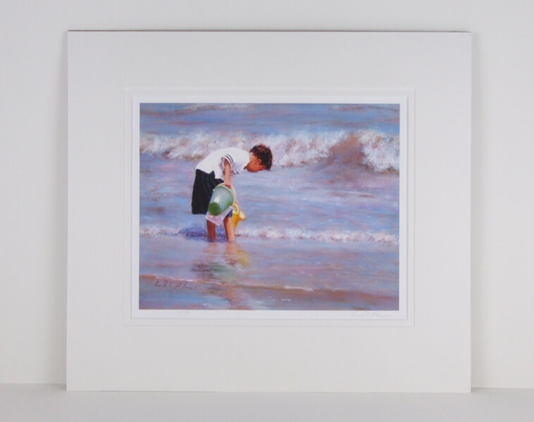 Filling the Pool picture of a boy paddling in the sea by Paul Milner mounted for sale