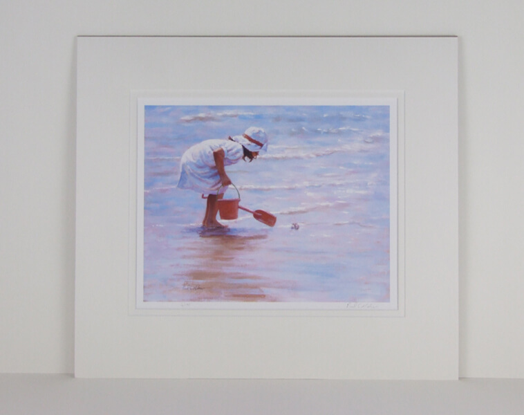 Meeting the Locals picture of a girl playing in the sea by artist Paul Milner mounted for sale
